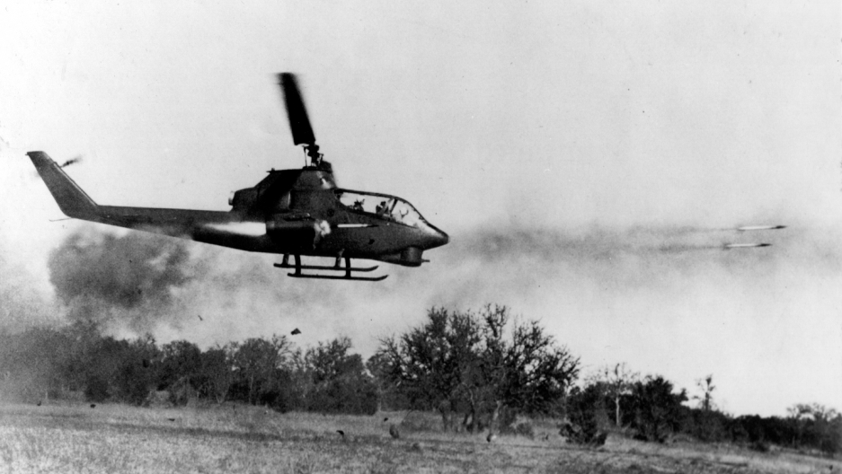 A US Huey Cobra fires rockets at an enemy target in Ia Drang, October 1965.