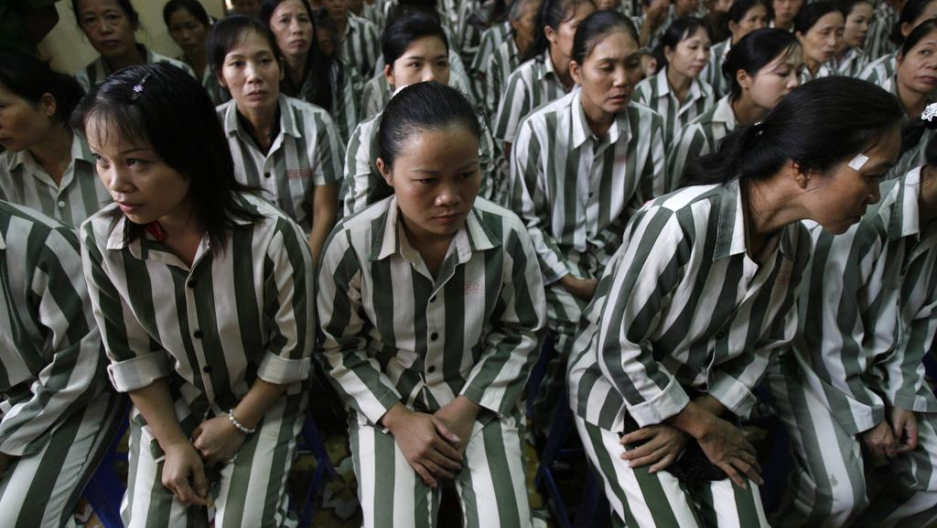 Inmates wait before they are released from Thanh Xuan prison outside Hanoi on Aug. 29, 2010.