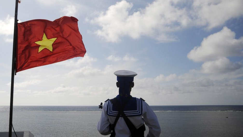 A Vietnamese naval soldier stands guard at Thuyen Chai island in the Spratly archipelago, Jan. 17, 2013.
