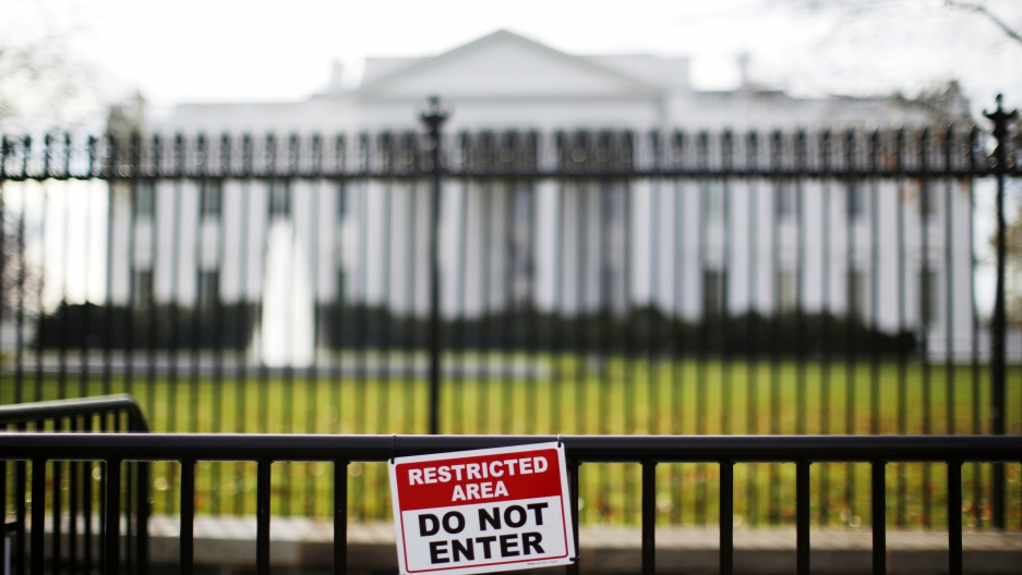 A restricted area sign is seen outside of the White House in Washington November 27, 2015.