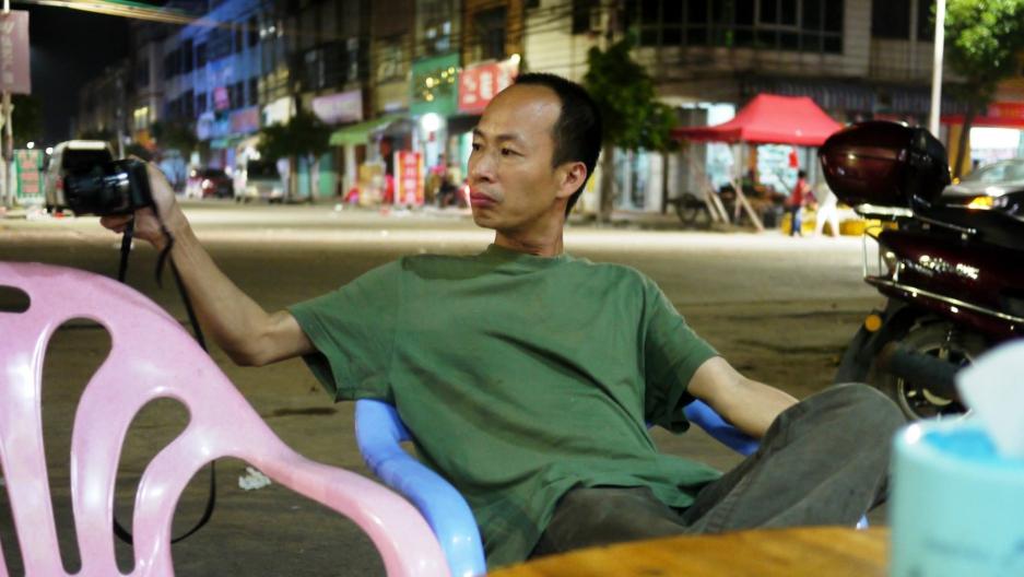 Filmmaker Zhu Rikun in his home village, Huang Niu Tian, Guangdong province in January, 2014.