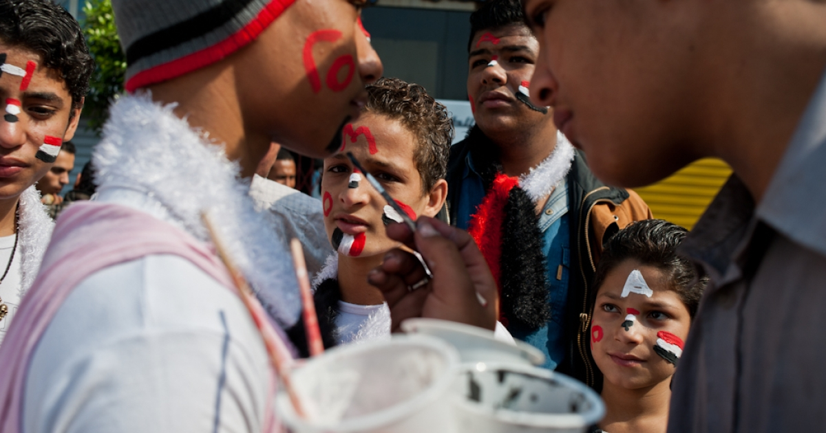 A group of boys get their faces painted with Egypt's flag in Tahrir Square in October 2011.</p>