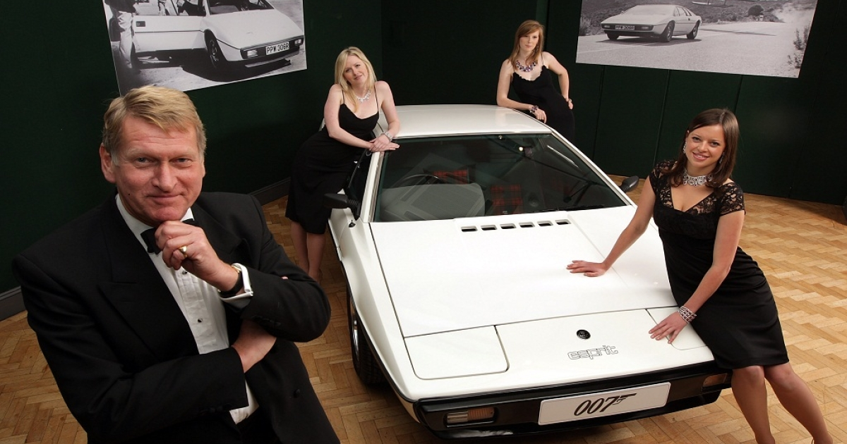 Staff from Bonhams auctioneers in London dressed as characters from a James Bond film pose with a white 1976 Lotus Esprit car from the 1977 film ' The Spy Who Loved Me ' in London, England on November 13, 2008. The Saab 900 Turbo is set be auctioned off on Jan. 20.</p>