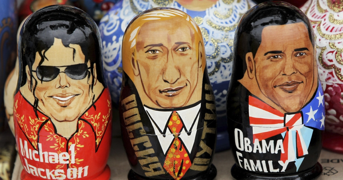 Matryoshka dolls in the likeness of late singer Michael Jackson, Russian Prime Minister Vladimir Putin and U.S. President Barack Obama stand on display at in St. Petersburg, Russia. Obama is finally calling to congratulate Putin on his recent election win, which international observers say is shadowed in fraud.</p>