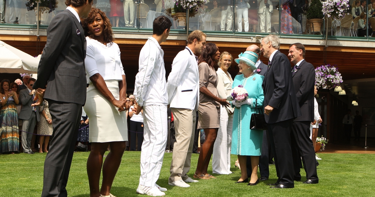 Queen Elizabeth II meets a lineup of tennis stars that includes Serena Williams (2nd L) and Caroline Wozniacki (R) at the Wimbledon Lawn Tennis Championships on Day 4 at the All England Lawn Tennis and Croquet Club on June 24, 2010 in London, England.</p>