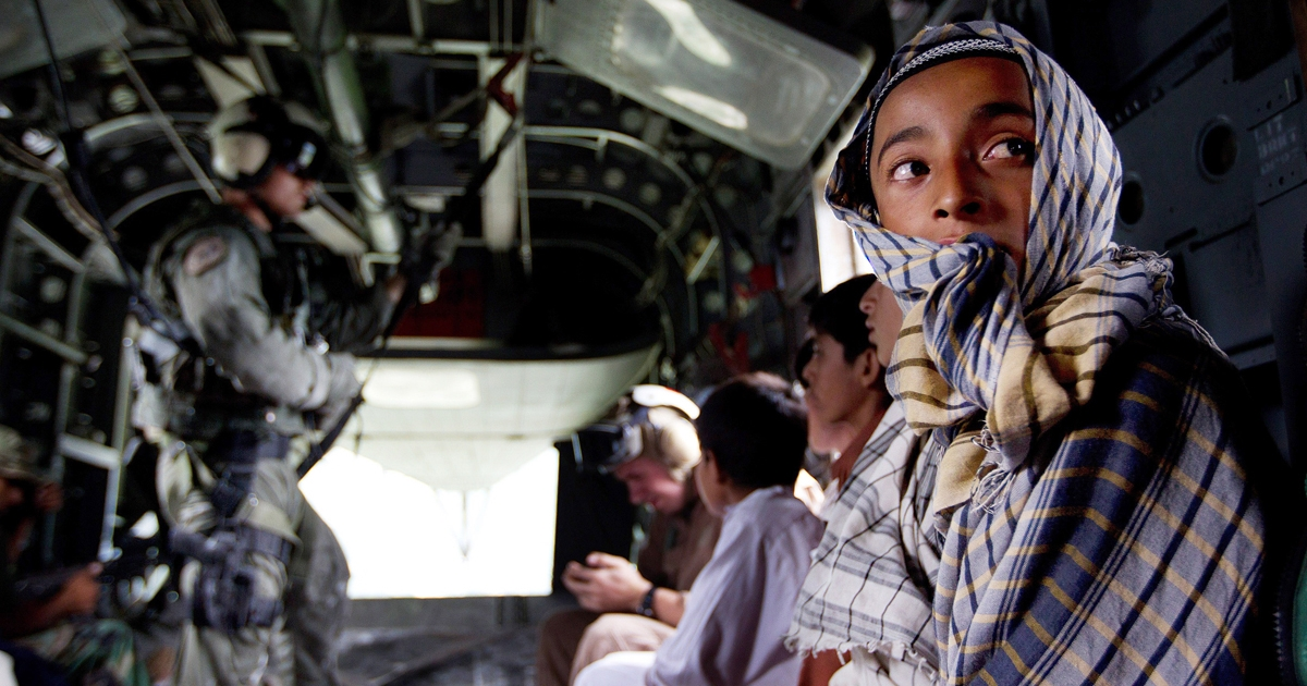 Pakistani flood victims sit in a U.S. Navy MH-53E helicopter during a rescue and aid mission by the U.S.</p>