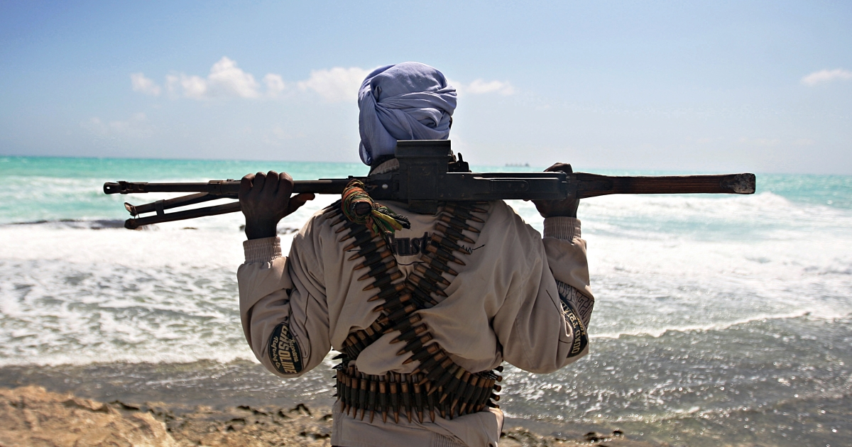 An armed pirate keeps vigil along the coastline at Hobyo town, northeastern Somalia on Jan. 7, 2010. A six-nation east African regional bloc on February 1, 2010 urged Somalia's two breakaway regions of Puntland and Somaliland to jointly battle Islamist militia which it said had extended to the areas.</p>
