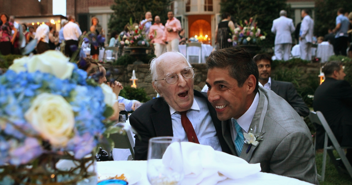 TV reporter Roby Chavez shares a moment with gay rights activist Frank Kameny (L) during Chavez's wedding ceremony with Chris Roe August 21, 2010 at the Woodrow Wilson House in Washington, DC.</p>