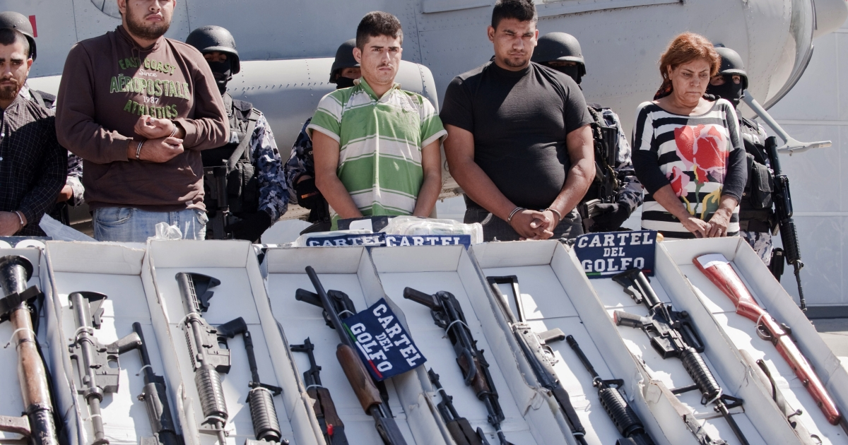Members of the Gulf Cartel detained in Tamaulipas State are shown to the press before a hangar of the Mexican Navy in Mexico City on September 29, 2010.</p>