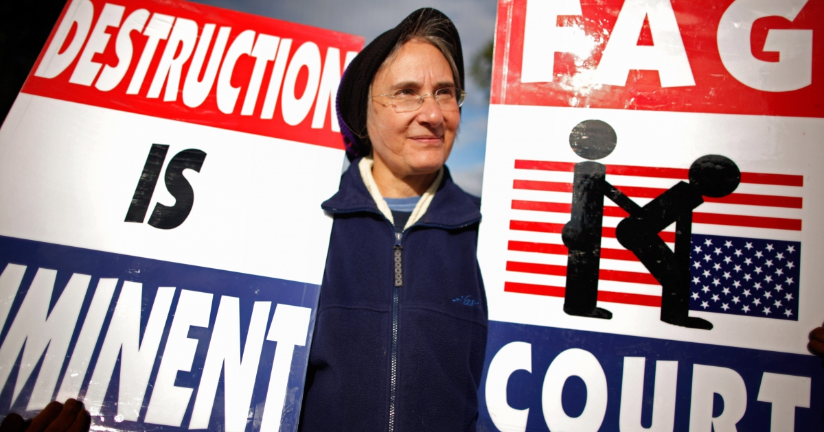 Betty Phelps, daughter-in-law of pastor Fred Phelps and a member of the Westboro Baptist Church, demonstrates outside the Supreme Court while justices hear oral arguements in Snyder v. Phelps, which tests the limits of the First Amendment, October 6, 2010 in Washington, DC.</p>