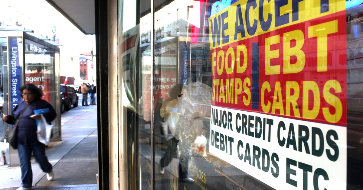 A sign in a market window advertises the acceptance of food stamps on October 7, 2010 in New York City. In Texas, a mother barricaded herself in a state welfare office for seven hours before shooting her two children and killing herself after being denied food stamps for months.</p>