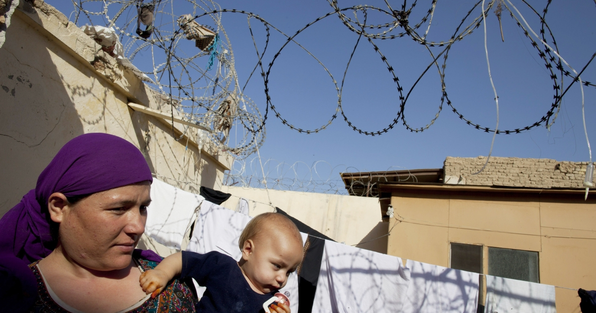 Ahsa Gul holds her son Sayed,11 months, inside the women's prison in Mazar-e-Sharif, Afghanistan on October 22, 2010. According to Afghanistan's Ministry for Women and the Independent Human Rights Commission, many women there are incarcerated are detained for