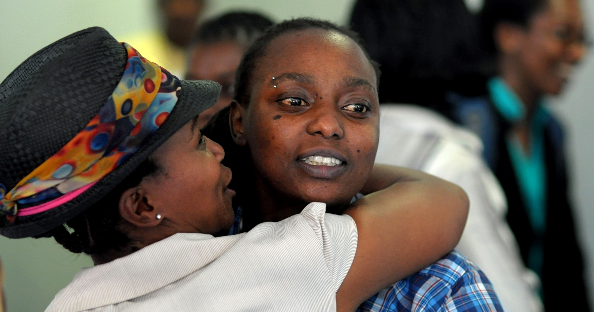 Two delegates greet one another at an international conference on sexual orientation, gender identity and human rights in on November 15, 2010 in Cape Town, South Africa. The conference focused on the challenges faced by the lesbian, gay, bisexual and transgender (LGBT) communities in Africa.</p>