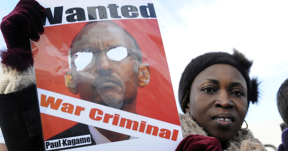 A demonstrator holds a poster showing Rawanda's President Paul Kagame in Brussels. South Africa is charging that Kagame's government sent agents to South Africa to assassinate a Rwandan critic of Kagame who has political asylum in South Africa.</p>