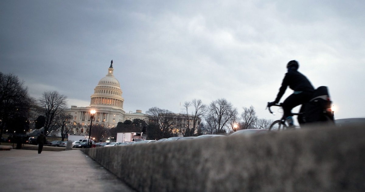 A biker rides toward the Capitol Building's rotunda on January 25, 2011 in Washington, DC.</p>