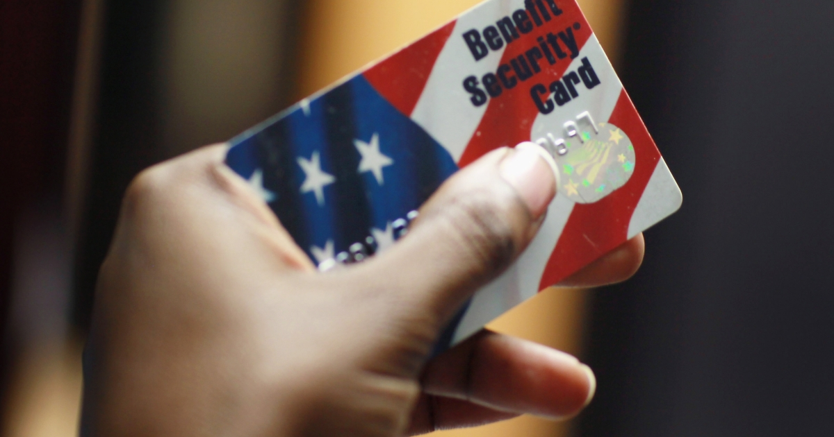 Kethia Dorelus a social worker with the Cooperative Feeding Program shows off a Federal food stamps card that is used to purchase food on February 10, 2011 in Fort Lauderdale, Florida.</p>