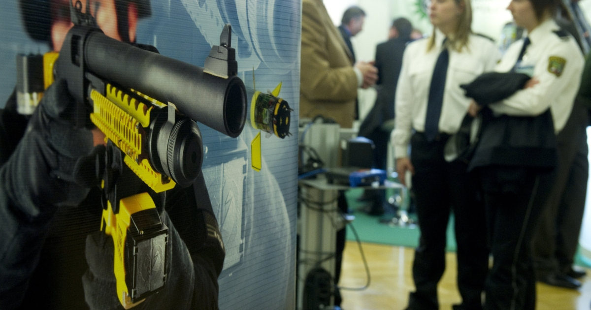 A poster advertising the Taser X-12 shot gun which can deliver the Taser XREP electronic control device by arms manufacturer Mossberg is seen at the Taser stand at the European Police Congress in Berlin February 15, 2011.</p>