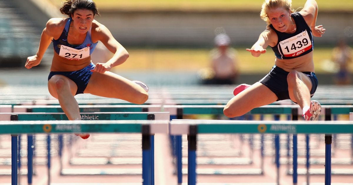 Michelle Jenneke (L) and Brooke Stratton compete in the Womens Under 20 100m Hurdles Final during day three of the Australian Junior Athletics Championships at Sydney Olympic Park Athletic Centre on March 12, 2011 in Sydney, Australia.</p>