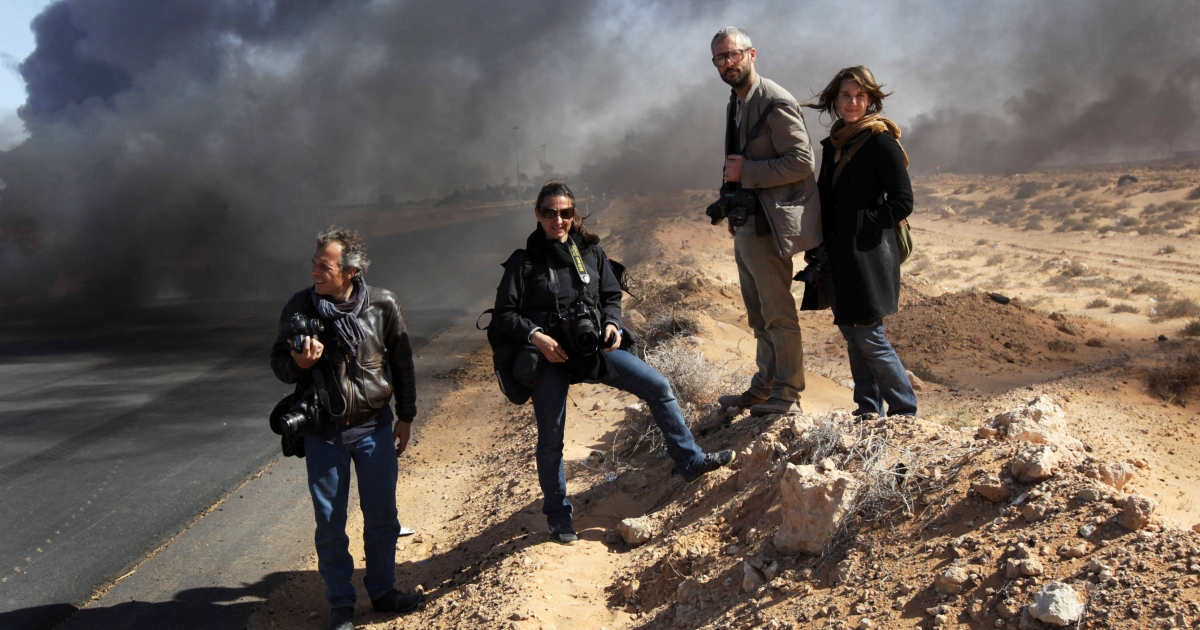A group of journalists, including Tyler Hicks (2nd from right) who was on assignment with Anthony Shadid when he died in Syria Thursday and carried his body out of the country, are pictured March 11, 2011 in Ras Lanuf, Libya, during a pause in the fighting.</p>