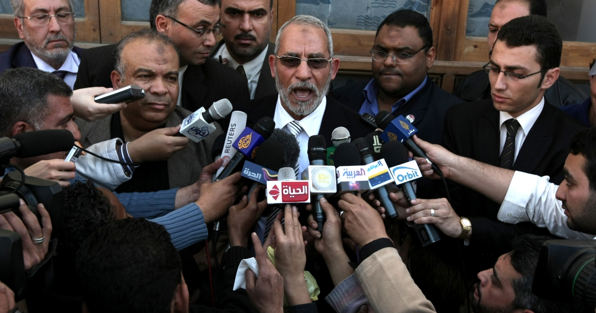 Mohammed Badie, the head of Egypt's Muslim Brotherhood speaks to the press outside a polling station in Cairo on March 19, 2011 as voters got their first taste of democracy in a referendum to a package of constitutional changes after president Hosni Mubarak was forced to relinquish his 30-year grip on power in the face of mass street protests.</p>