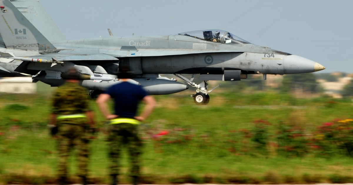 A Canadian F18 jet fighter from the 425 Tactical Fighter squadron lands upon arrival from a mission at Trapani-Birgi airbase in Sicily.</p>