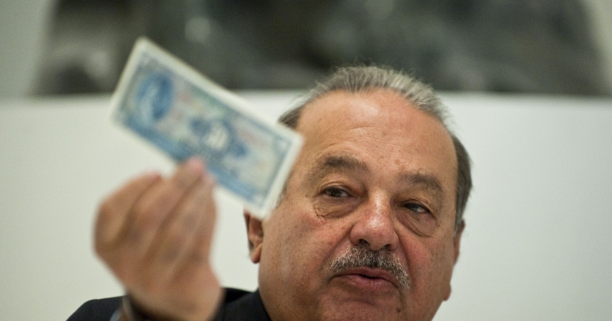 Mexican tycoon Carlos Slim speaks during a press conference at the Soumaya Museum in Mexico City, on the eve of its opening to the public, on March 28, 2011.</p>