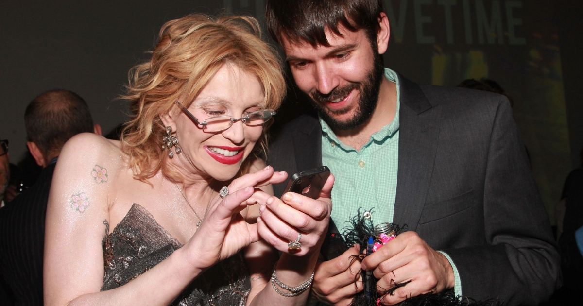 Courtney Love shares a photo on her iPhone with a reporter on May 5, 2011 in New York City. Apple unveiled its iPhone 4s on Oct. 4.</p>