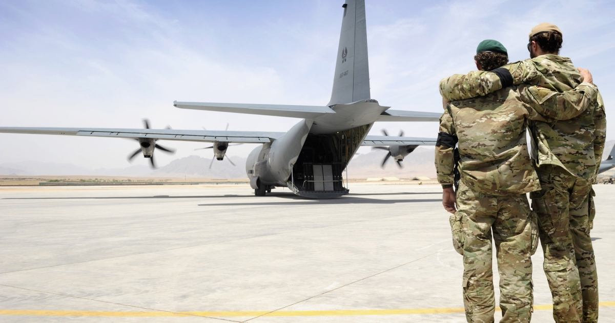 Two special forces soldiers embrace as the C-130 carrying Sergeant Brett Wood,who was killed in action,  departs Tarin Kot Airfield, Saturday, May 28, 2011, in Uruzgan, Afghanistan.  32 Australian soldiers have been killed in Afghanistan since 2001.</p>