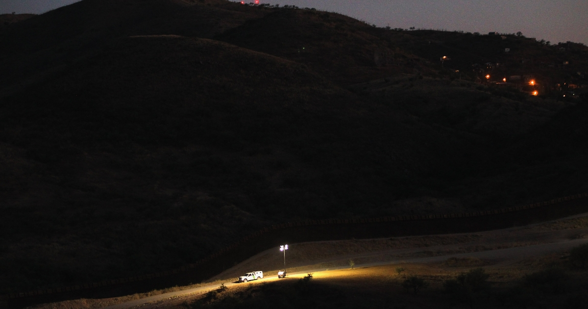 A US Border Patrol vehicle moves along the border fence with Mexico on June 22, 2011 in Nogales, Arizona.</p>
