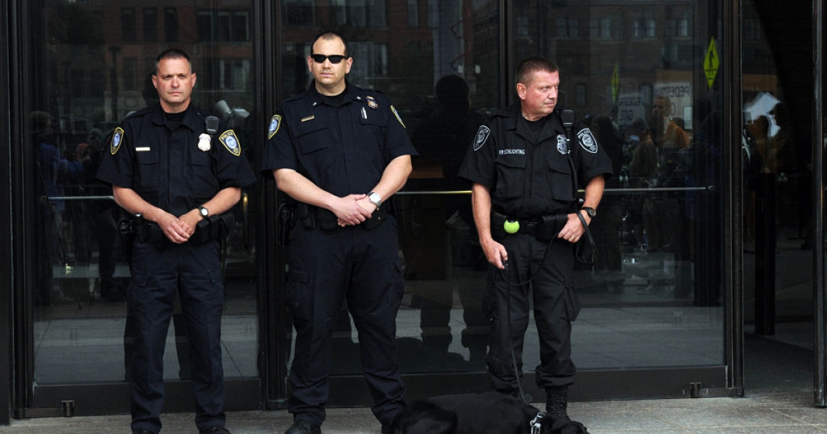BOSTON - JUNE 24: State and local police stand outside the John Joseph Moakley United States Courthouse amid heavy security as James 'Whitey' Bulger and girlfriend Catherine Greig are arraigned June 24, 2011 in Boston, Massachusetts. Bulger is wanted for the alleged murders of 19 people dating back to the mid 90's and Greig is wanted for harboring a criminal. Both were arrested in Santa Monica, California on Wednesday after 16 years on the run.</p>
