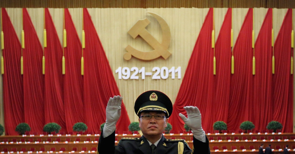 Chinese military band conductor rehearses ahead of the celebration of the Communist Party's 90th anniversary at the Great Hall of the People on July 1, 2011 in Beijing, China.</p>