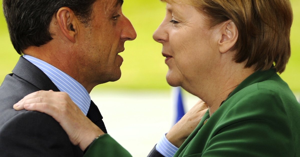 A familiar sight, but a comfortable one? German Chancellor Angela Merkel meets French President Nicolas Sarkozy on July 20, 2011 in Berlin with a form of greeting that one German groups thinks should be outlawed.</p>