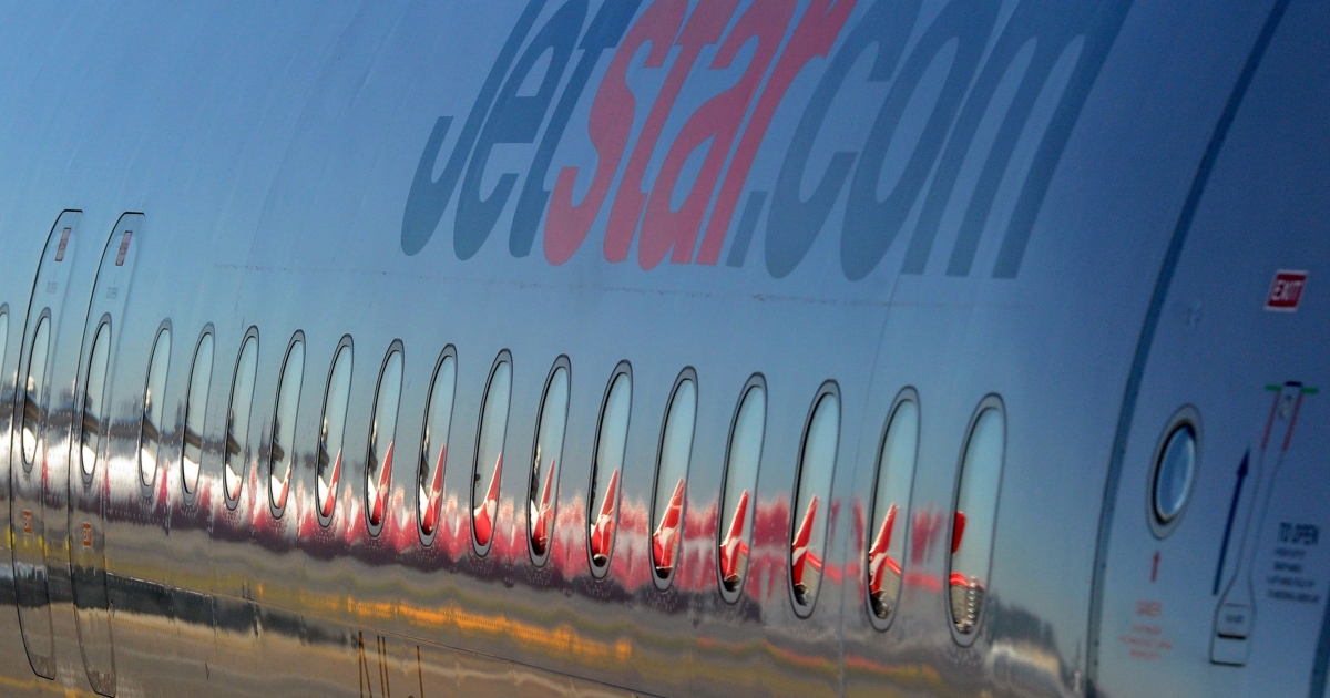 Barrel of laughs? Not quite. Jetstar has received unwanted attention over a midair incident in which a drunk teenager reportedly urinated on a sleeping 11-year-old girl. The tail of a Qantas aircraft is reflected in the windows of this JetStar A320 Airbus at Sydney Airport on July 28, 2011.</p>