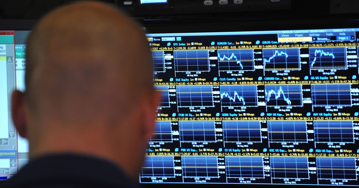 A traders watches prices at his post at the New York Stock Exchange at the opening bell August 8, 2011.</p>
