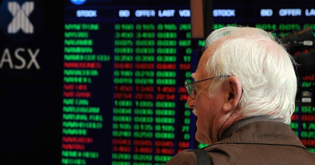 An investor watches market indices monitors at the Australian Stock Exchange (ASX) during morning trade in Sydney on August 11, 2011.</p>