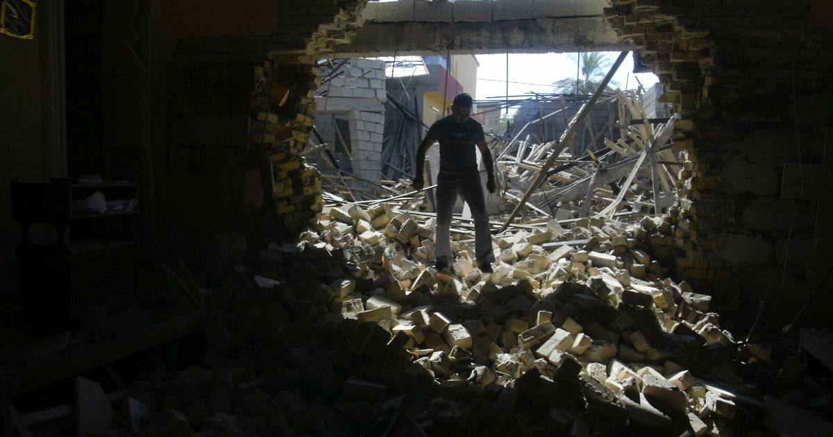 An Iraqi man inspects damages at the Mar Afram Syriac Orthodox Church following an explosion in the northern city of Kirkuk on Aug. 15, 2011 as a series of nationwide attacks hit the country.</p>