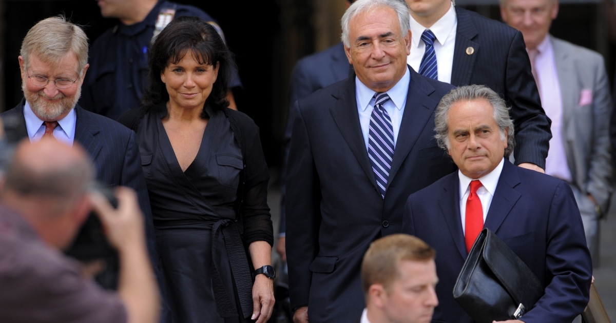 Former IMF head Dominique Strauss-Kahn (2nd R) and his wife Anne Sinclair (2nd L) with lawyers Benjamin Brafman (R) and William Taylor (L) leave a hearing at New York State Supreme Court August 23, 2011 in New York.</p>