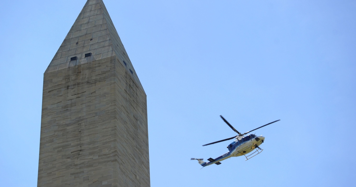 A Parks Police helicopter inspects the Washington Monument shortly after an earthquake struck Washington, DC August 23, 2011. One of the strongest earthquakes to strike the U.S. east coast in decades rattled offices Tuesday in downtown Washington and caused panicked evacuations from skyscrapers as far away as New York. The Pentagon, the US Capitol and Union Station in the nation's capital were all evacuated after the 5.9-magnitude quake, which was shallow with its epicenter only 0.6 miles (one kilometer) underground.</p>