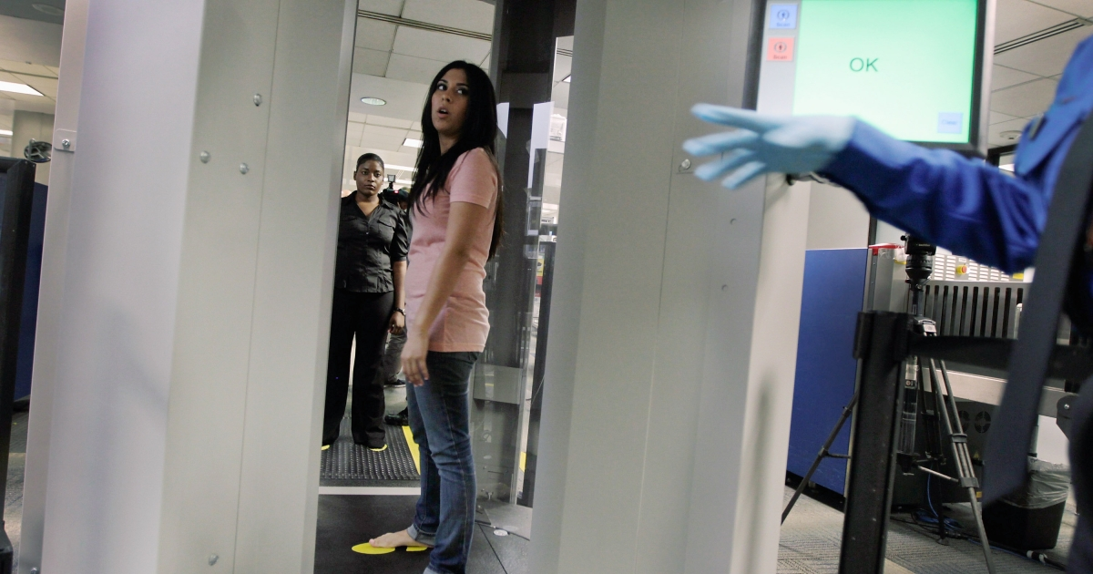 A TSA employee, who couldn't provide her name, demostrates the new  advanced imaging technology software known as Automated Target Recognition that has been installed at Miami International Airport on August 23, 2011 in Miami, Florida.</p>