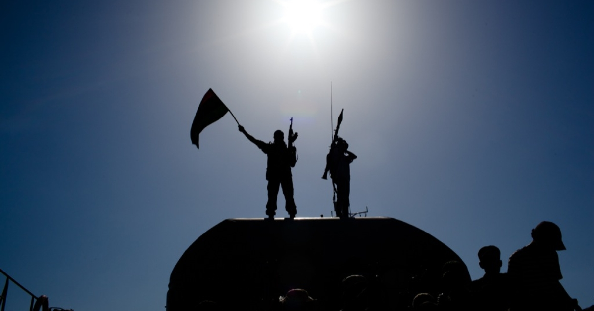 Libyan rebel soldiers celebrate as they arrive on an ex-Libyan Army frigate from Bengazi on August 30, 2011 in Tripoli, Libya.</p>