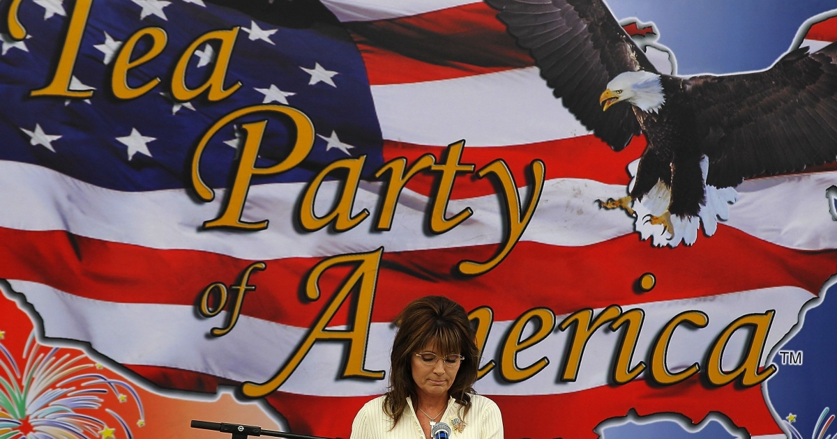 Former Alaska governor Sarah Palin pauses as she speaks during the Tea Party of America's