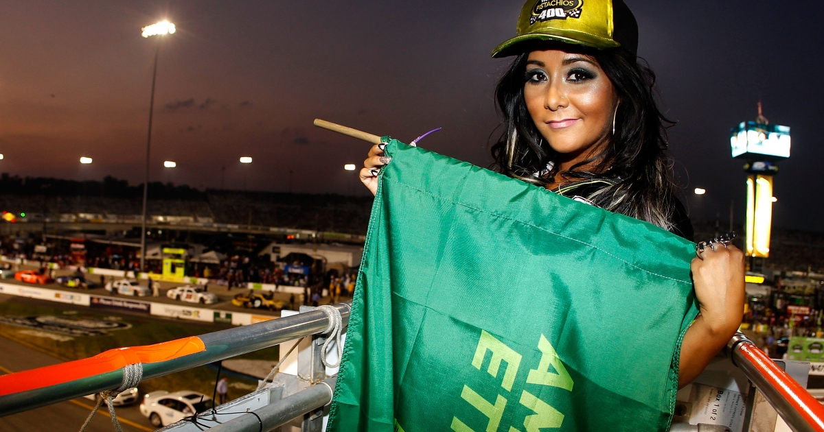 TV personality Nicole 'Snookie' Polizzi poses with the green flag prior to the NASCAR Sprint Cup Series Wonderful Pistachios 400 at Richmond International Raceway on September 10, 2011 in Richmond, Virginia.</p>