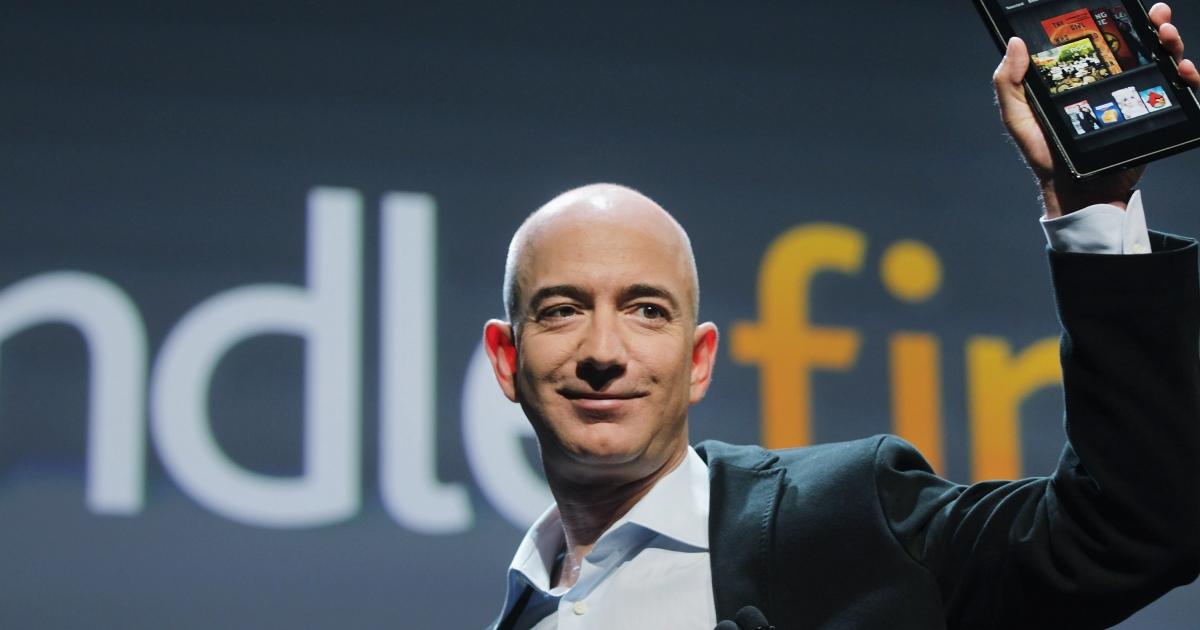 Amazon founder Jeff Bezos holds the tablet computer Kindle Fire on September 28, 2011 in New York City.</p>