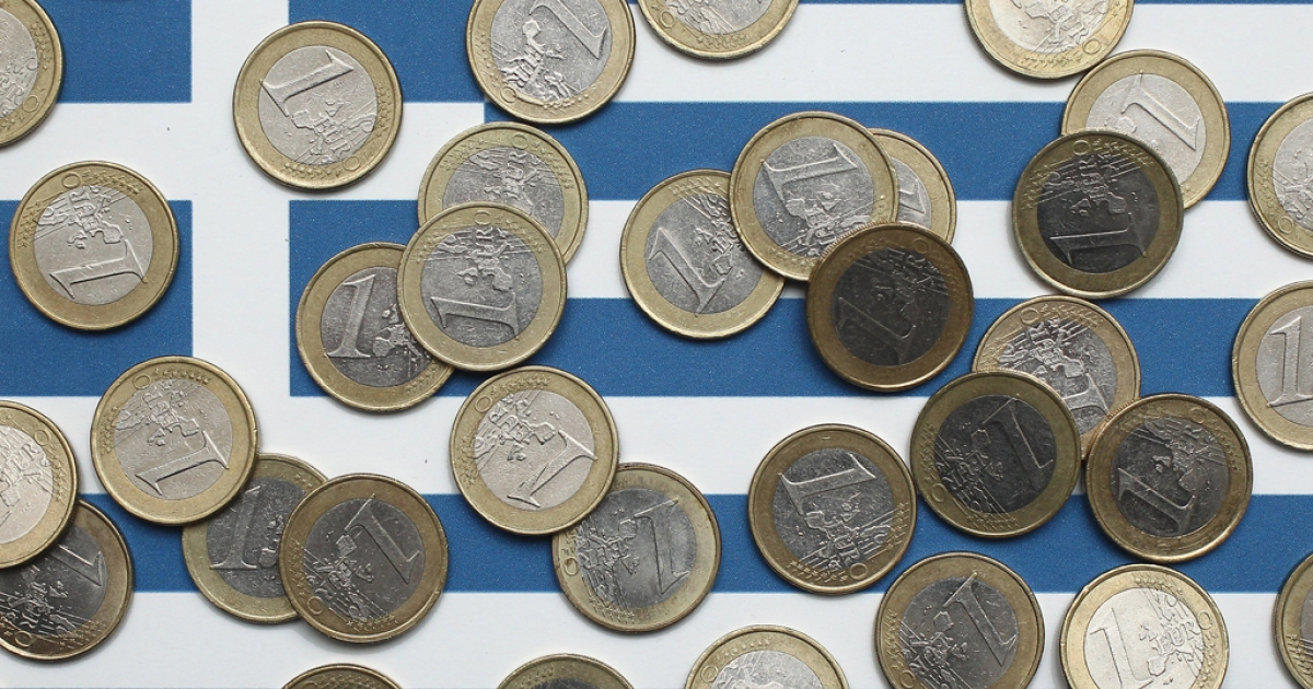 In this photo illustration a Greek flag is covered with one Euro coins on October 4, 2011 in Berlin, Germany.</p>