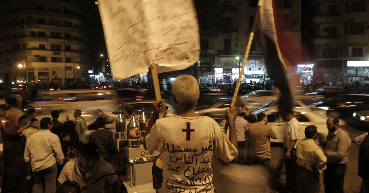 Nearly 3,000 Egyptian mourners gather in in Cairo's Tahrir Square on October 15, 2011 for a candlelight vigil in honor of Coptic Christians among 27 people killed during a demonstration over an attack on a church. Egypt's ruling military approved on October 15 a law to punish discrimination.</p>