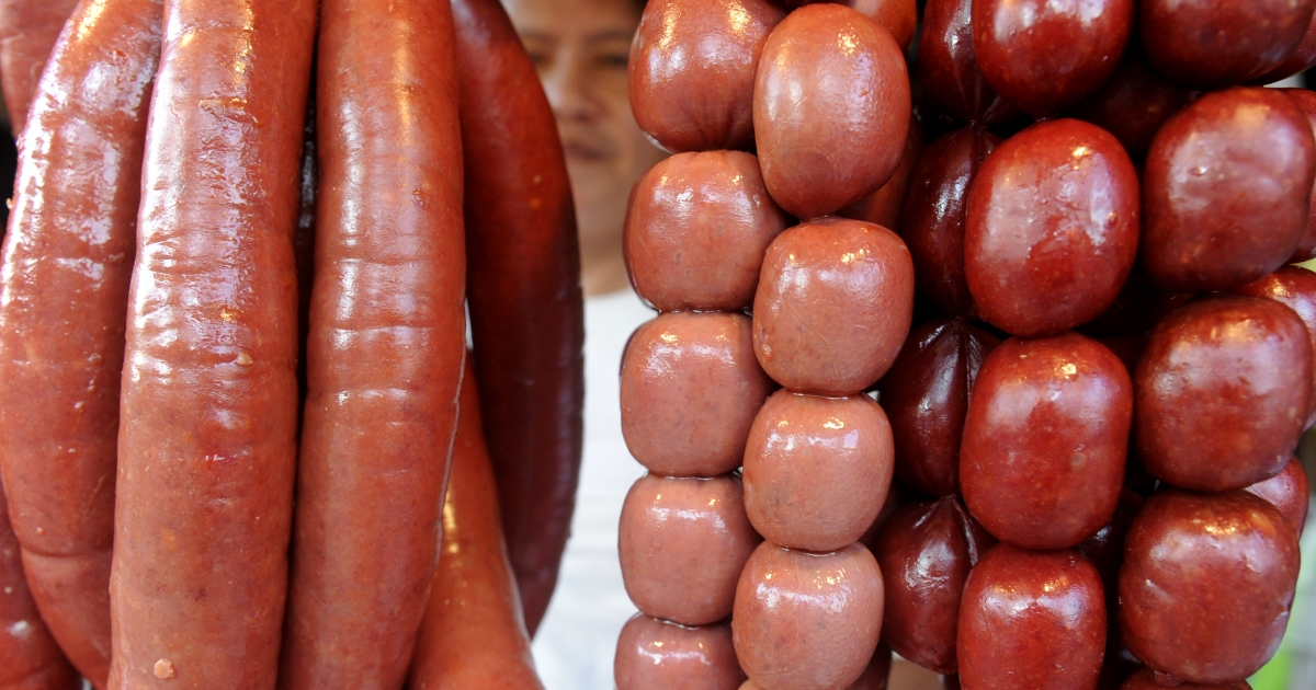 Sausages are displayed for sale at a stall in Manila on October 16, 2011.</p>