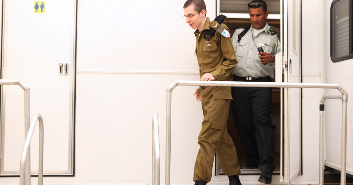 In this handout photo provided by the Israeli Defence Force, freed Israeli soldier Gilad Shalit walks out at Tel Nof Airbase on October 18, 2011 in central Israel. Shalit was freed after being held captive for five years in Gaza by Hamas militants, in a deal which saw Israel releasing more than 1,000 Palestinian prisoners.</p>