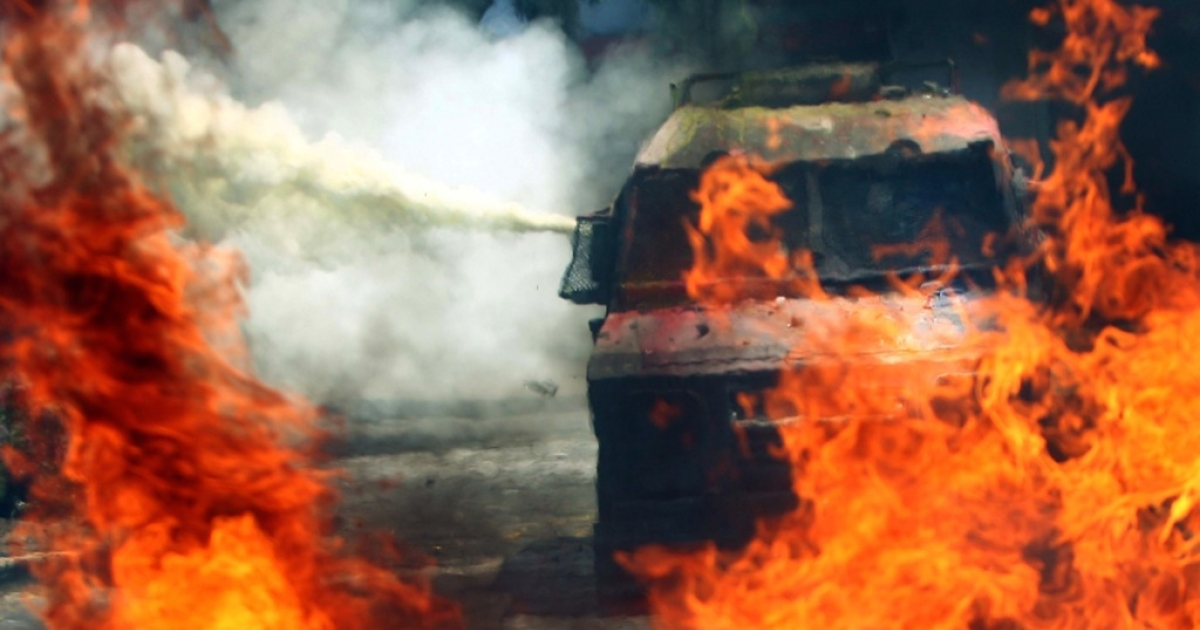 A riot police tear gas truck clash with students during a demonstrations demanding free higher education in Santiago, on October 19, 2011, as bonfires and barricades were set in different points of the Chile's capital.</p>