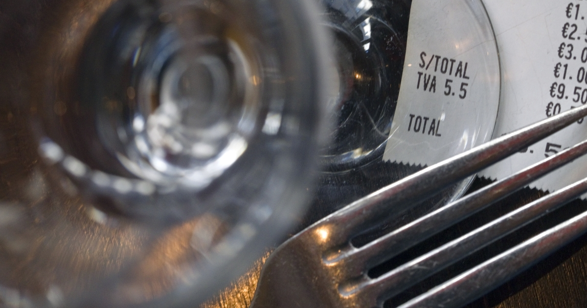 A picture taken on November 4, 2011 at a restaurant in Paris shows a fork and a glass near an invoice indicating the 5.5 percent rate of the Value-added tax (VAT).</p>