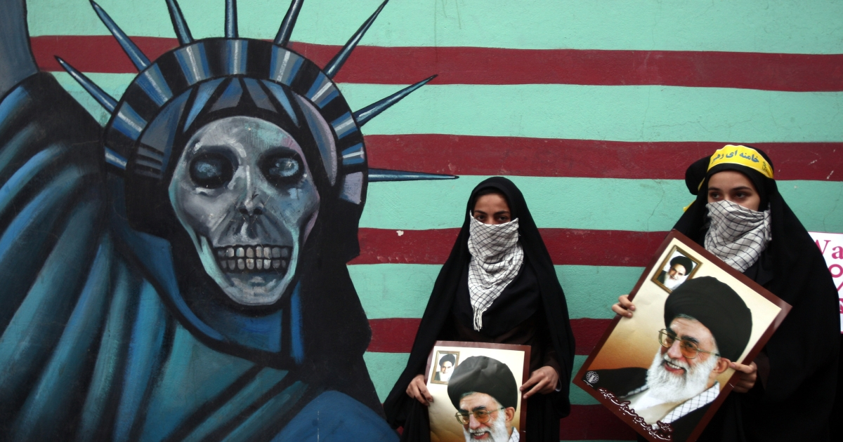Iranian women hold pictures of Supreme Leader Ayatollah Khamenei outside the former US embassy in Tehran on November 4, 2011, during a rally  to mark the storming of the American embassy by Iranian students 32 years ago.</p>